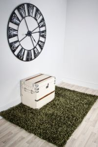green grass rug with trunk