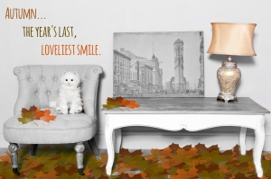 Cream chair, landscape picture, gold crackle lamp and white coffee table autumn